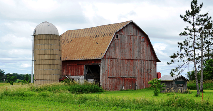 farmhouse with silo agricultural land